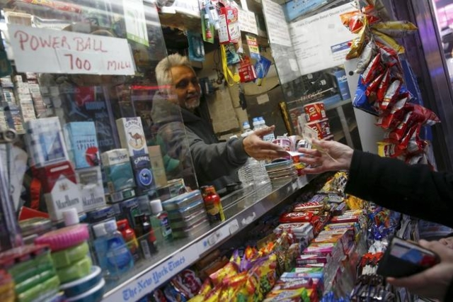 A vendor sells a ticket for the $700 million Powerball lottery draw at Times Square in the Manhattan borough of New York January 7, 2016. (Shannon Stapleton/Reuters)