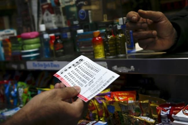 A man purchases a ticket for the $700 million Powerball lottery draw at Times Square in the Manhattan borough of New York in New York January 7, 2016. (Shannon Stapleton/Reuters)