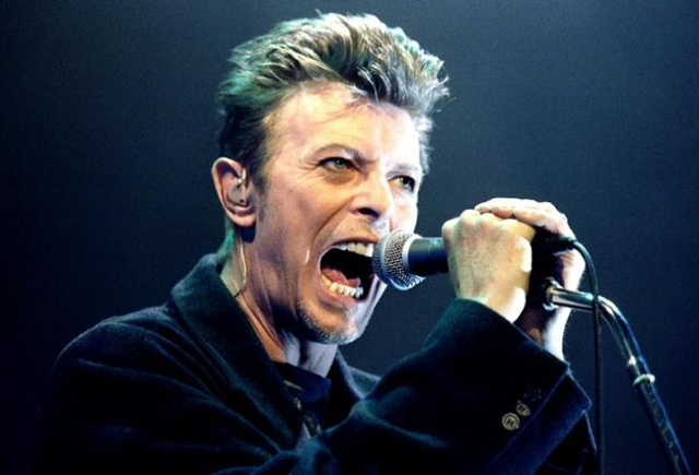 David Bowie performs during a concert in Vienna, Austria in this February 4, 1996 file photo. (Leonhard Foeger/Reuters)