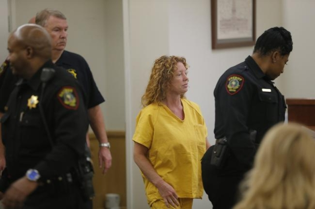 Tonya Couch, center, enters the courtroom to appear before state District Judge Wayne Salvant in Fort Worth, Texas, Jan. 8, 2016. (Rodger Mallison/Fort Worth Star-Telegram/Reuters/Pool)