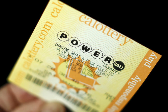 A Powerball lottery ticket is shown in this illustration photograph in Encinitas, California January 8, 2016. The jackpot in the Powerball lottery, already the largest ever payout in North America ...