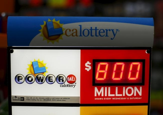 A corner store displays a Powerball lottery sign next to its cash register and checkout in Encinitas, California January 8, 2016. The jackpot in the Powerball lottery, already the largest ever pay ...