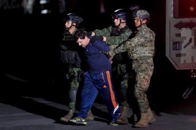"Drug lord Joaquin ""El Chapo"" Guzman is escorted by soldiers during a presentation in Mexico City, January 8, 2016. (Tomas Bravo/Reuters)"