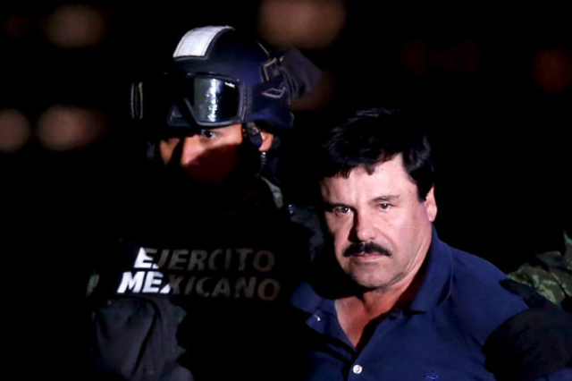 "Joaquin ""El Chapo"" Guzman is escorted by soldiers during a presentation at the hangar belonging to the office of the Attorney General in Mexico City, Mexico January 8, 2016.  REUTERS/Edg ..."