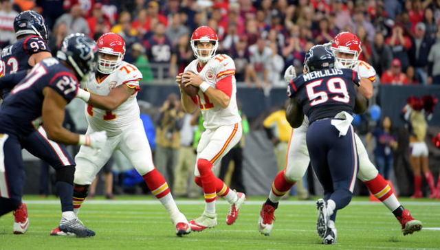 Kansas City Chiefs quarterback Alex Smith (11) looks to pass against the Houston Texans during the in the second quarter in a AFC Wild Card playoff football game at NRG Stadium. Mandatory Credit:  ...