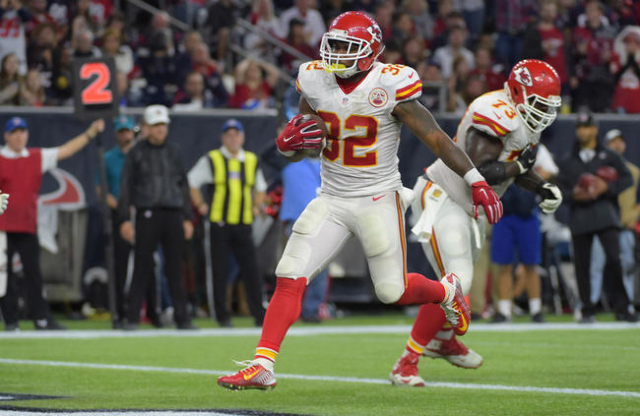 Kansas City Chiefs running back Spencer Ware (32) scores a touchdown against the Houston Texans in the fourth quarter in a AFC Wild Card playoff football game at NRG Stadium. Kansas City won 30-0. ...