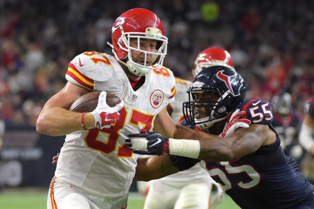 Kansas City Chiefs tight end Travis Kelce (87) is pushed out of bounds by Houston Texans inside linebacker Benardrick McKinney (55) during the in the third quarter in a AFC Wild Card playoff footb ...