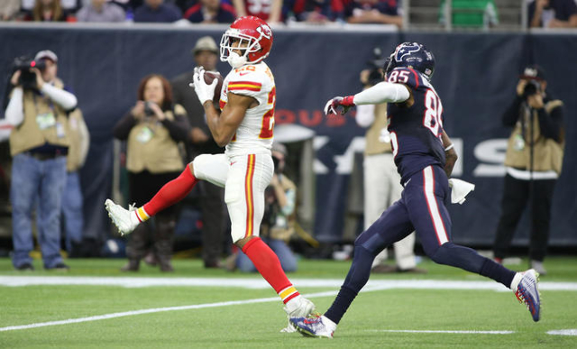 Kansas City Chiefs cornerback Marcus Peters (22) intercepts a pass intended for Houston Texans wide receiver Nate Washington (85) during the second quarter in a AFC Wild Card playoff football game ...