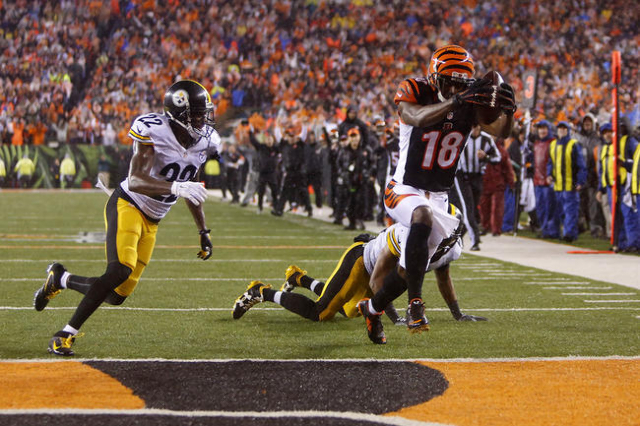 Cincinnati Bengals wide receiver A.J. Green (18) scores a touchdown against Pittsburgh Steelers cornerback William Gay (22) during the fourth quarter in the AFC Wild Card playoff football game at  ...