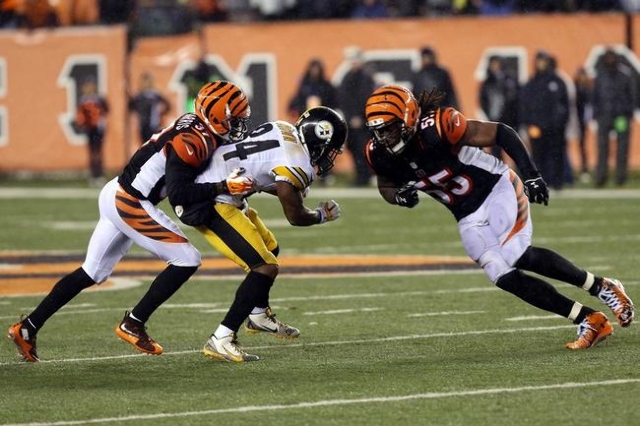 Cincinnati Bengals outside linebacker Vontaze Burfict (55) hits Pittsburgh Steelers wide receiver Antonio Brown (84) during the fourth quarter in the AFC Wild Card playoff football game at Paul Br ...