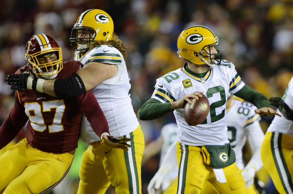 Jan 10, 2016; Landover, MD, USA; Green Bay Packers quarterback Aaron Rodgers (12) prepares to throw the ball in front of Washington Redskins defensive end Jason Hatcher (97) during the second half ...