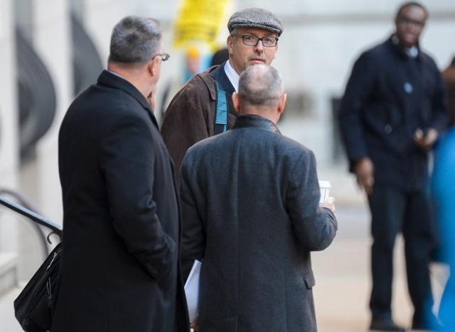 Gary Proctor, attorney for Officer William Porter (not pictured), departs the courthouse for the first day of jury selection in the case of Officer Caesar Goodson in Baltimore, Jan. 11, 2016.  (Br ...