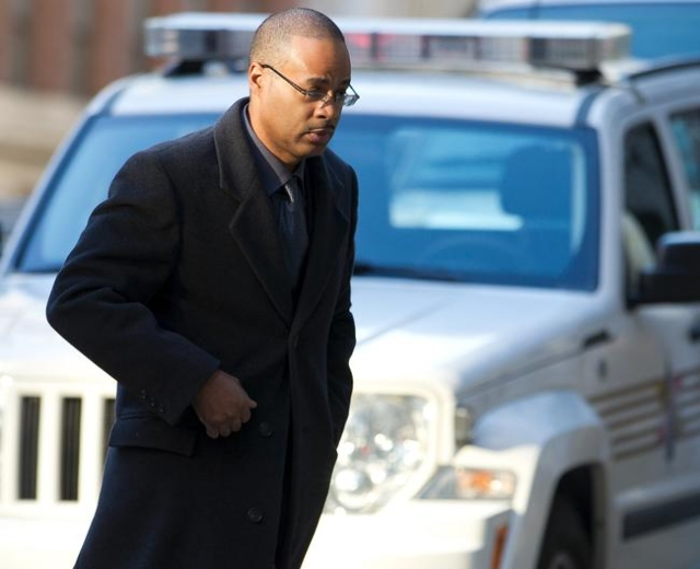 Caesar Goodson arrives at the courthouse for the first day of jury selection in Baltimore, Jan. 11, 2016. Goodson, charged with several offenses including second-degree murder, is the second of si ...