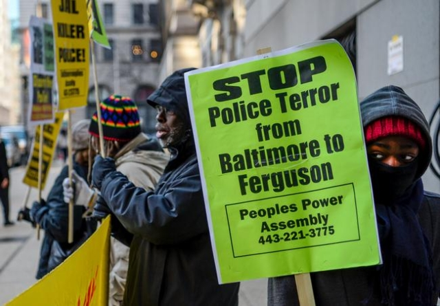 Protesters gathers near the steps of the courthouse where jury selection takes place for the case of Officer Caesar Goodson, in Baltimore, Jan, 11, 2016. (Bryan Woolston/Reuters)