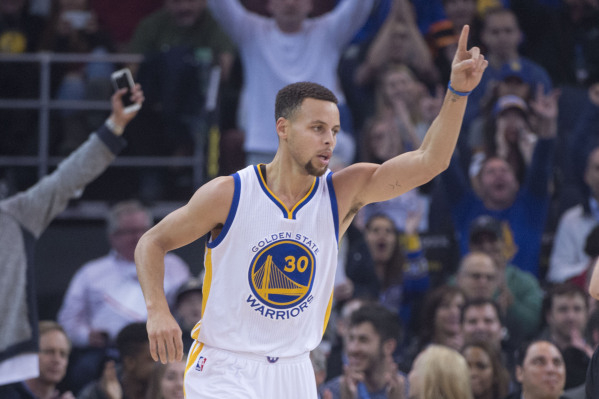 January 11, 2016; Oakland, CA, USA; Golden State Warriors guard Stephen Curry (30) celebrates against the Miami Heat during the first quarter at Oracle Arena. (Kyle Terada/USA Today Sports)