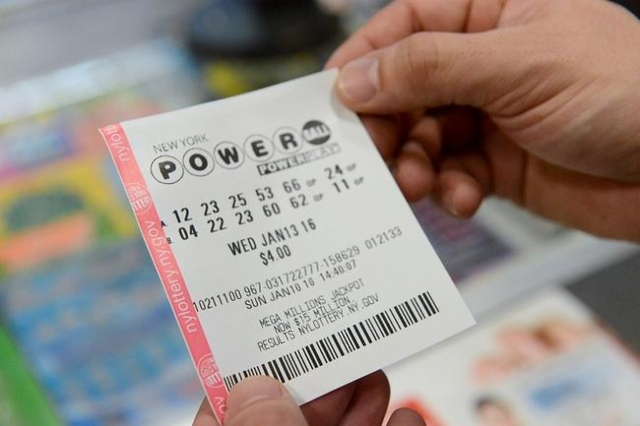 A person holds a Powerball ticket in New York January 10, 2016. (Reuters/Stephanie Keith)