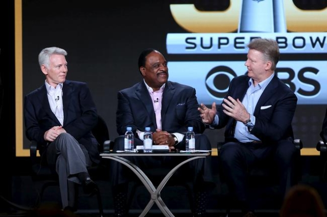 Sean McManus, left, chairmen of CBS Sports, James Brown, center, host of The Super Bowl Sunday and Phil Simms, analyst for Super Bowl 50 on CBS Sports appear at the CBS Sports panel at the Televis ...