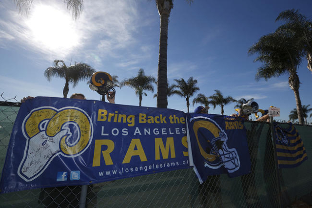 NFL fans Tom Bateman (L) Skye Sverdlin, Daniel Balma, and Joe Ramirez, show their support for the St. Louis Rams NFL team to come to Los Angeles at a news conference to unveil plans for developmen ...