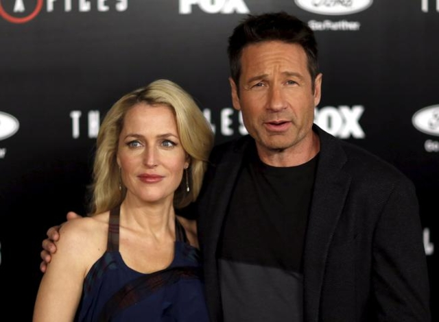 "Cast members Gillian Anderson and David Duchovny pose at a premiere for ""The X-Files"" at California Science Center in Los Angeles, California January 12, 2016. A 6-episode series premier ..."