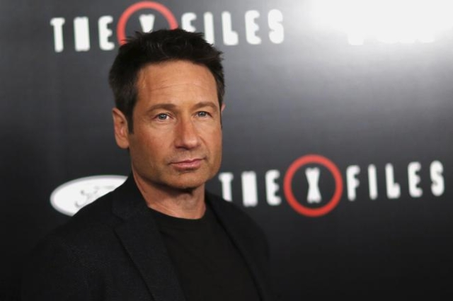 "Cast member David Duchovny poses at a premiere for ""The X-Files"" at California Science Center in Los Angeles, California January 12, 2016. A 6-episode series premieres on January 24. (Ma ..."