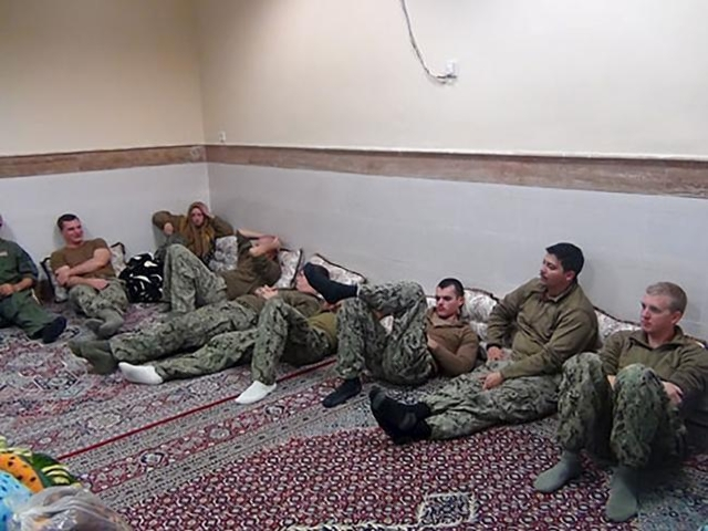 An undated picture released by Iran's Revolutionary Guards website shows American sailors sitting in a unknown place in Iran. (sepahnews.ir/TIMA/Handout via Reuters)