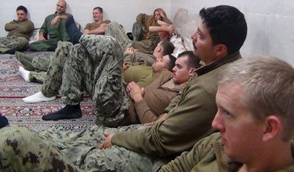 U.S. sailors are seen in an undisclosed location in Iran in this handout picture released on Farsnews website on January 13, 2016. (farsnews.com/Handout via Reuters)