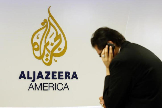 A man works at a desk in the Al Jazeera America broadcast center in New York, August 20, 2013. (Brendan McDermid/Reuters)