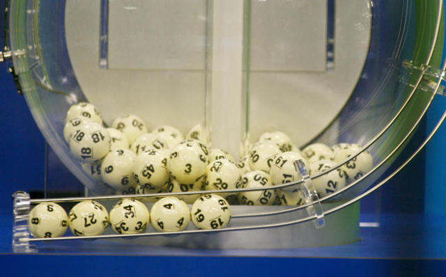 The winning Powerball numbers are shown after being drawn at the Florida Lottery studio in Tallahassee, Florida January 13, 2016. The winning numbers are 8-27-34-4-19 and the Powerball number is 1 ...