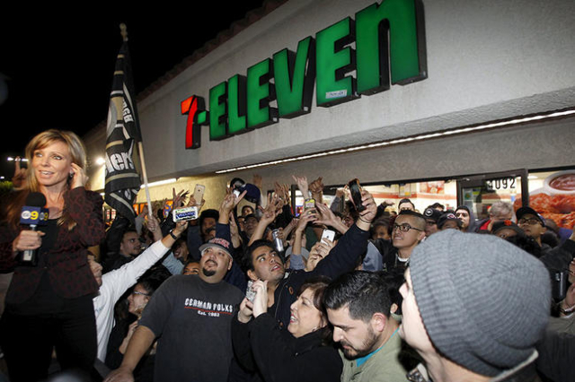 A crowd gathers in front of the 7-Eleven store where a winning Powerball ticket was sold, in Chino Hills, California January 13, 2016. A winning ticket was sold there for the massive $1.59 billion ...