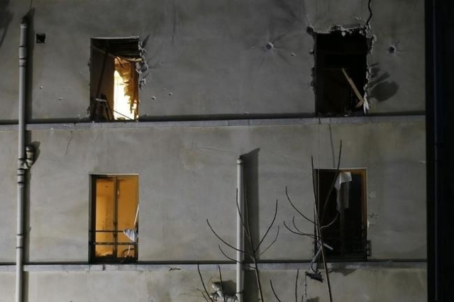 A view shows impacts around windows on the facade of the apartment raided by French Police special forces earlier in Saint-Denis, near Paris, France, November 18, 2015 during an operation to catch ...