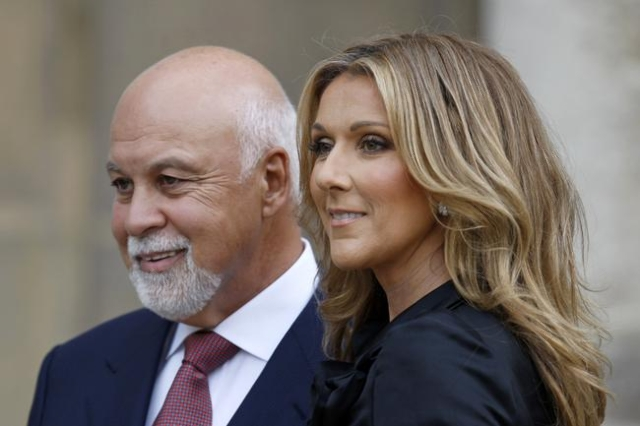 Canadian singer Celine Dion poses with husband Rene Angelil after she was awarded with France's Legion d'Honneur in Paris, May 22, 2008. Angelil died Jan. 14, 2016, at the age of 73 af ...
