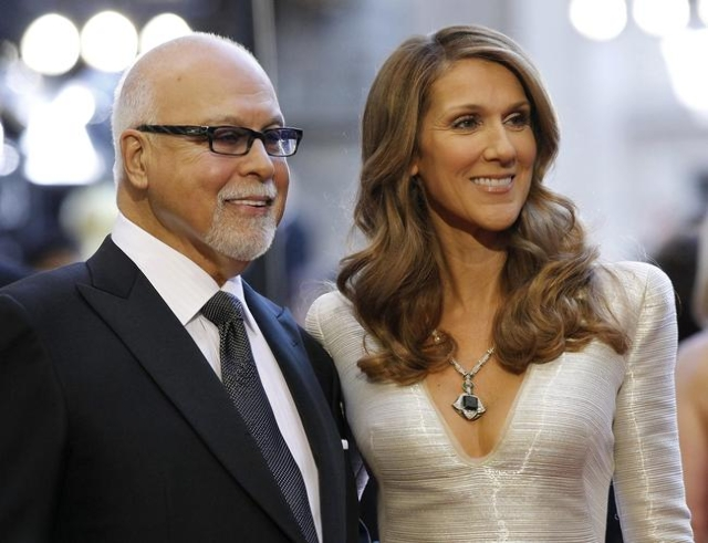 Singer Celine Dion and her husband, Rene Angelil, arrive at the 83rd Academy Awards in Hollywood, California, Febr.  27, 2011. (Mario Anzuoni/Files/Reuters)