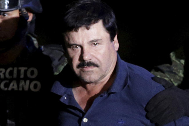 "Recaptured drug lord Joaquin ""El Chapo"" Guzman is escorted by soldiers at the hangar belonging to the office of the Attorney General in Mexico City, Mexico in this January 8, 2016, file  ..."