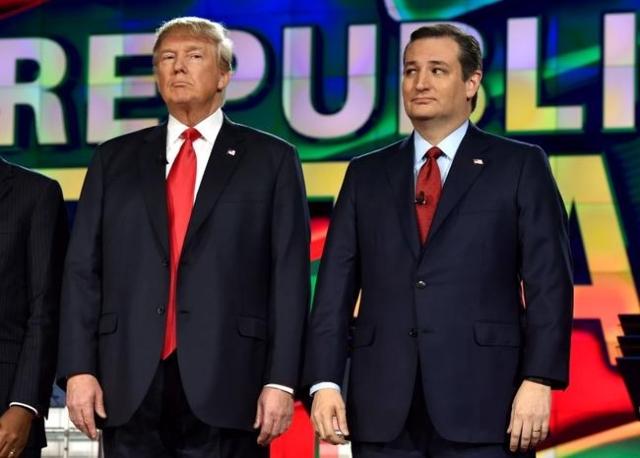 Republican U.S. presidential candidates businessman Donald Trump (L) and Senator Ted Cruz (R) pose together before the start of the Republican presidential debate in Las Vegas, Nevada December 15, ...