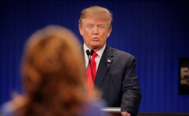 Republican U.S. presidential candidate businessman Donald Trump reacts during the Fox Business Network Republican presidential candidates debate in North Charleston, South Carolina January 14, 201 ...
