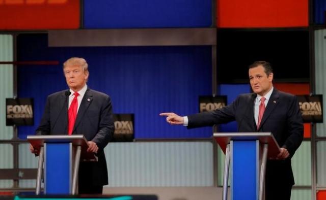 Republican U.S. presidential candidate Senator Ted Cruz gestures towards rival candidate businessman Donald Trump (L) as he speaks at the Fox Business Network Republican presidential candidates de ...