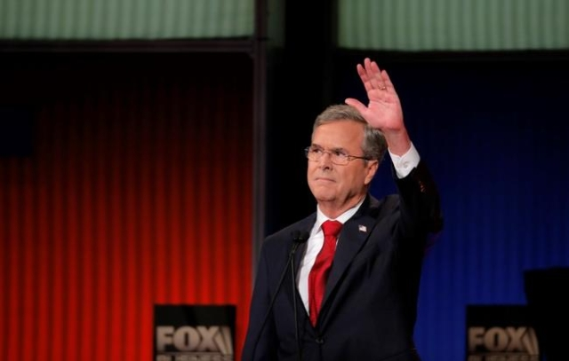 Republican U.S. presidential candidate and former Governor Jeb Bush waves to the audience at the Fox Business Network Republican presidential candidates debate in North Charleston, South Carolina, ...