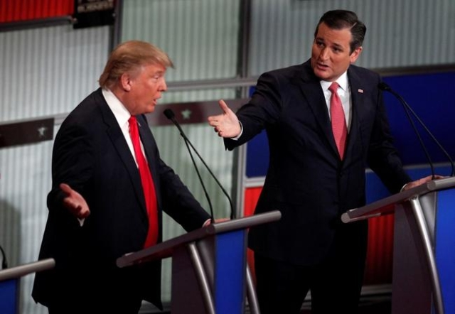 Republican U.S. presidential candidate businessman Donald Trump (L) and Senator Ted Cruz speak simultaneously at the Fox Business Network Republican presidential candidates debate in North Charles ...