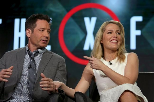 Actors David Duchovny and Gillian Anderson speak during the Fox Network presentation at the Television Critics Association winter press tour in Pasadena, California January 15, 2016. (David McNew/ ...