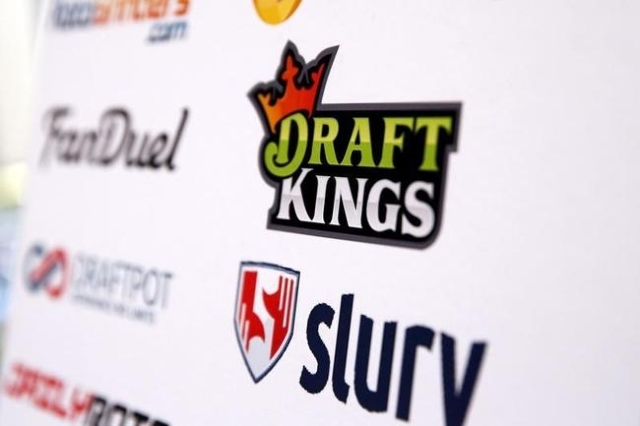 A DraftKings logo is displayed on a board inside of the DFS Players Conference in New York, Nov. 13, 2015. (Lucas Jackson/Reuters)