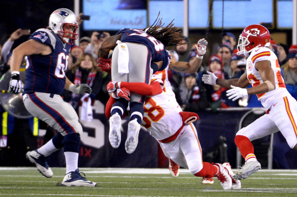 Kansas City Chiefs strong safety Ron Parker (38) tackles New England Patriots running back Steven Jackson (39) during the second quarter in the AFC Divisional round playoff game at Gillette Stadiu ...