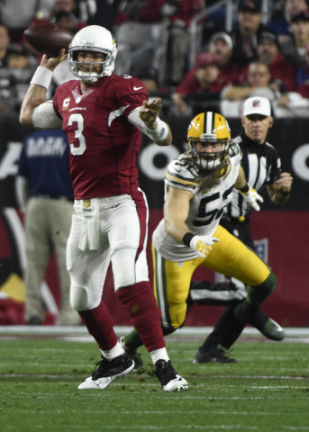 Arizona Cardinals quarterback Carson Palmer (3) throws ahead of Green Bay Packers inside linebacker Clay Matthews (52) during the first half in a NFC Divisional round playoff game at University of ...