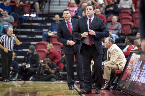 Jan 16, 2016; Las Vegas, NV, USA; UNLV Rebels head coach Todd Simon fixes his jacket during a game against the Air Force Falcons during the first half at Thomas & Mack Center. Mandatory Credit ...