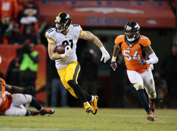 Pittsburgh Steelers tight end Jesse James (81) runs for extra yards after a catch with Denver Broncos inside linebacker Brandon Marshall (54) chasing during the fourth quarter in a AFC Divisional  ...