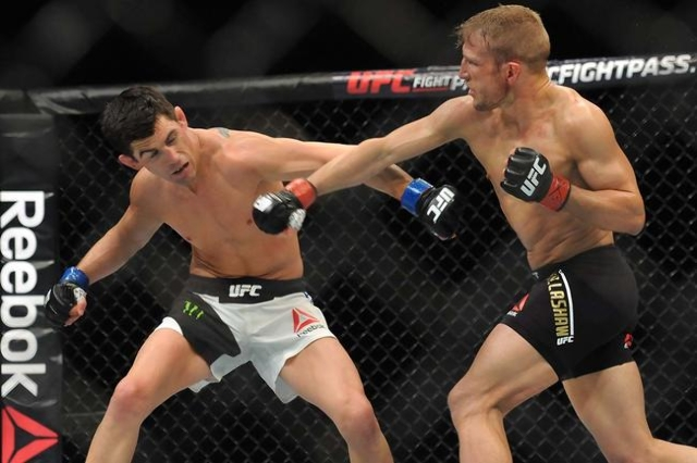 Jan 17, 2016; Boston, MA, USA; TJ Dillashaw (red) punches Dominick Cruz (blue) during a world bantamweight championship bout at UFC Fight Night at the TD Garden. (Bob DeChiara/USA Today Sports)
