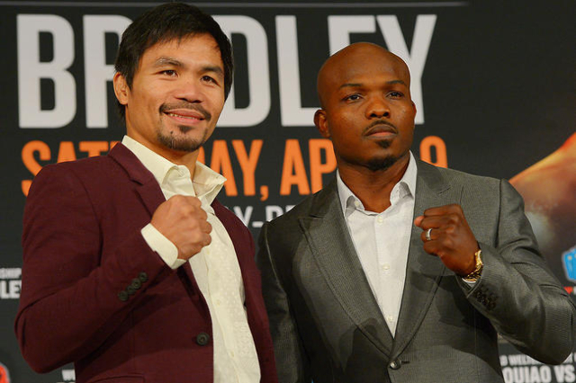 Jan 19, 2016; Beverly Hills, CA, USA; Manny Pacquiao and Timothy Bradley, Jr face off during a press conference at the Beverly Hills Hotel to announce their upcoming boxing fight. (Jayne Kamin-Onc ...