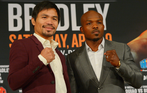 Jan 19, 2016; Beverly Hills, CA, USA; Manny Pacquiao and Timothy Bradley, Jr face off during a press conference at the Beverly Hills Hotel to announce their upcoming boxing fight. Mandatory Credit ...