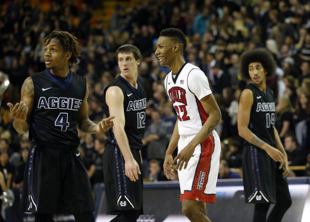 Jan 19, 2016; Logan, UT, USA; The Utah State Aggies guard Shane Rector (4), forward Lew Evans (12) and forward Jalen Moore (14) look on as UNLV Rebels guard Patrick McCaw (22) reacts in the final  ...