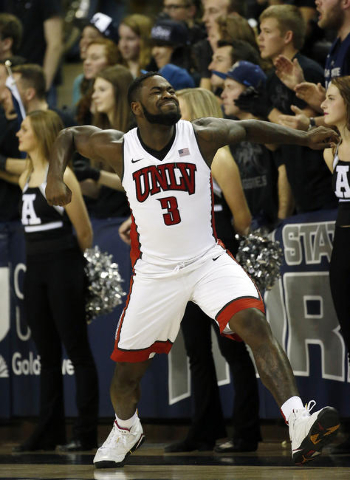 Jan 19, 2016; Logan, UT, USA; UNLV Rebels guard Jordan Cornish (3) reacts after a three-pointer in the second half against the Utah State Aggies at Dee Glen Smith Spectrum. The UNLV Rebels defeate ...