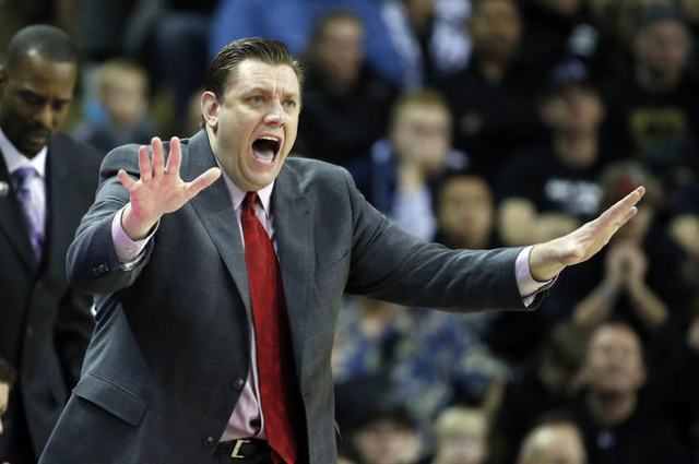 Jan 19, 2016; Logan, UT, USA; UNLV Rebels head coach Todd Simon directs his team in the second half against the Utah State Aggies at Dee Glen Smith Spectrum. The UNLV Rebels defeated the Utah Stat ...